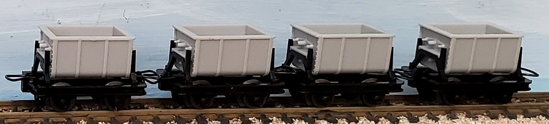 Four Cement cars